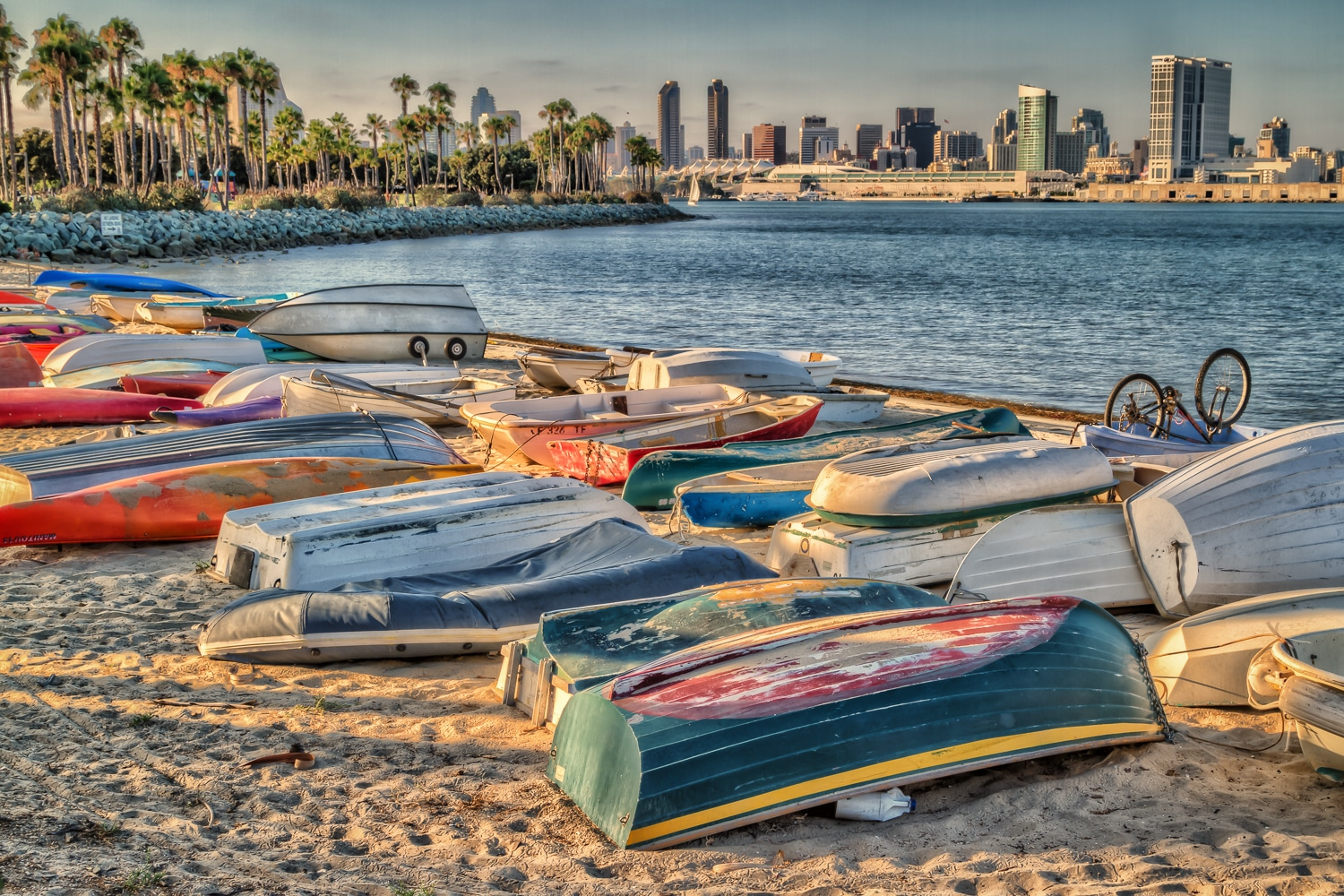 Brightly Colored Abandoned Fishing Boats on a Coronado Beach