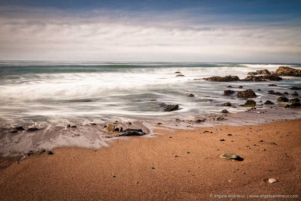 Long exposure waves over rocks and beach | Cambria, CA
