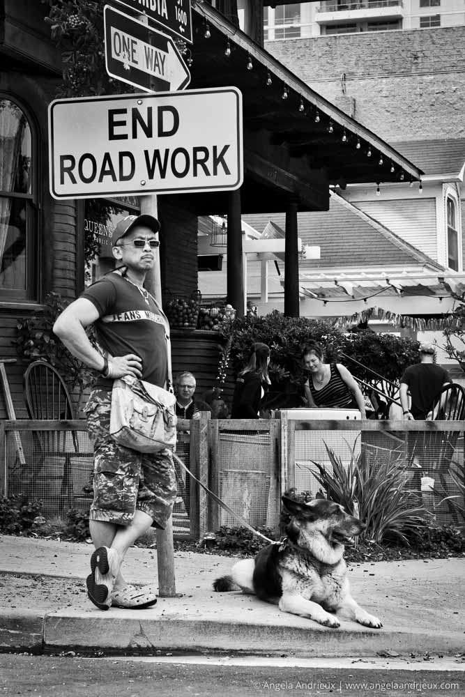Man by sign with German Shepherd | Street Photography | Little Italy Mercado | San Diego, CA