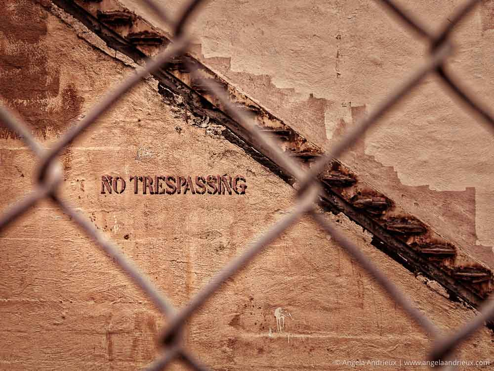 No Trespassing Shot through a chain link fence | Urban Decay | San Diego, CA