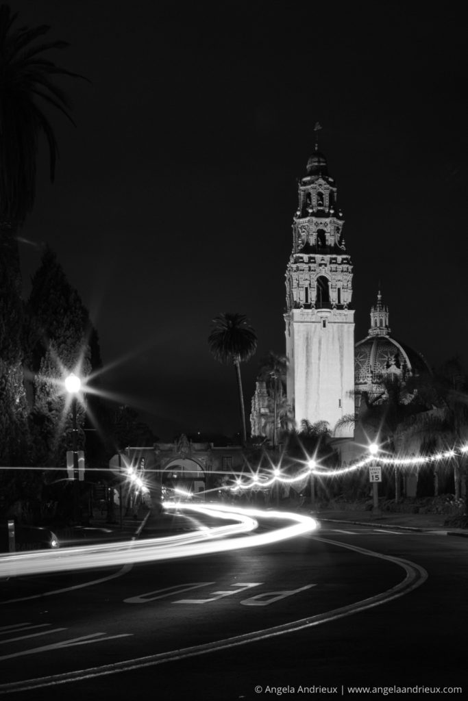Balboa Park at Night in black and white with light trails from a car