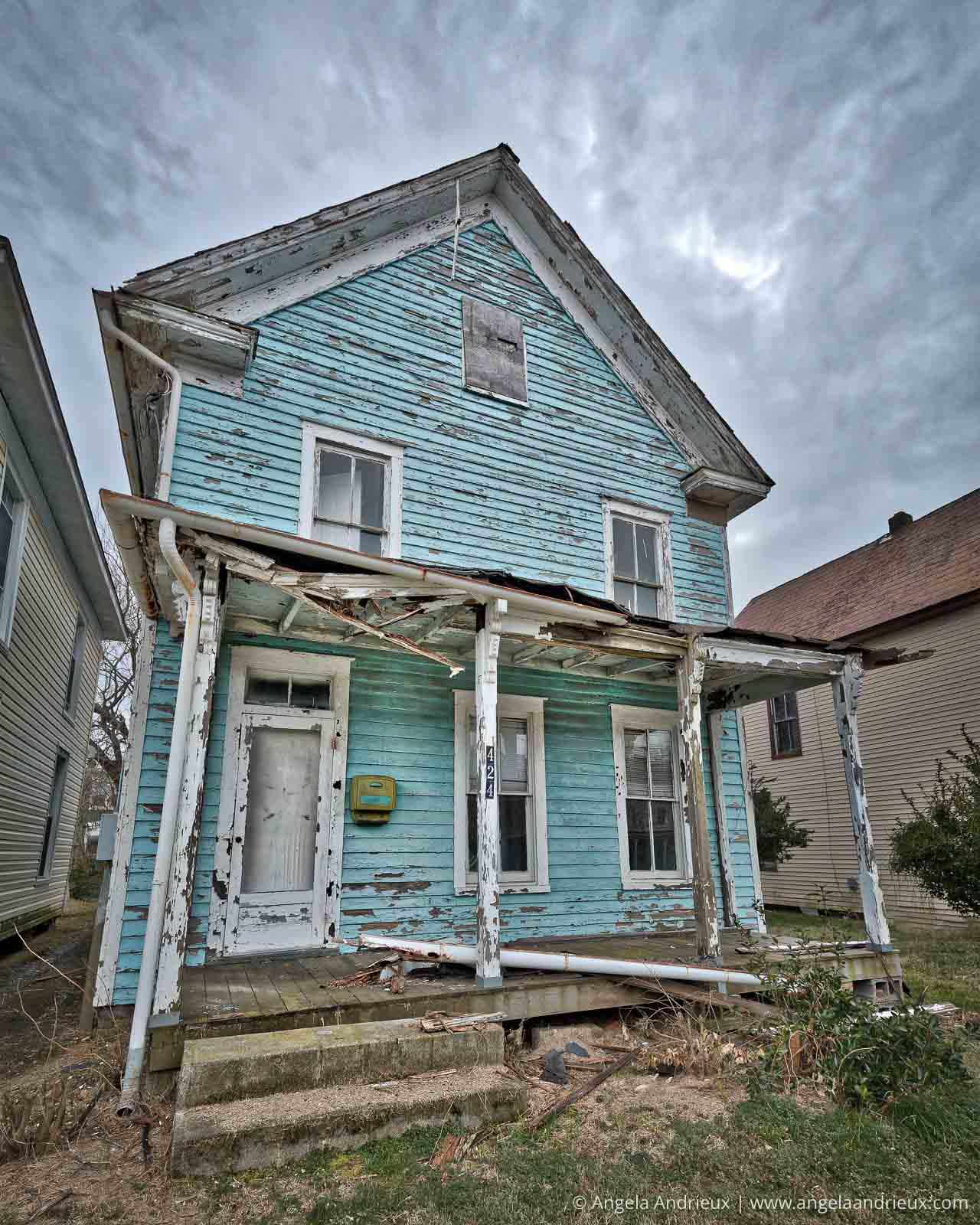 Turquoise decaying and abandoned beach cottage in Cape Charles, VA