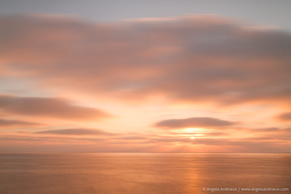 Long exposure sunset with pink clouds in San Diego, CA