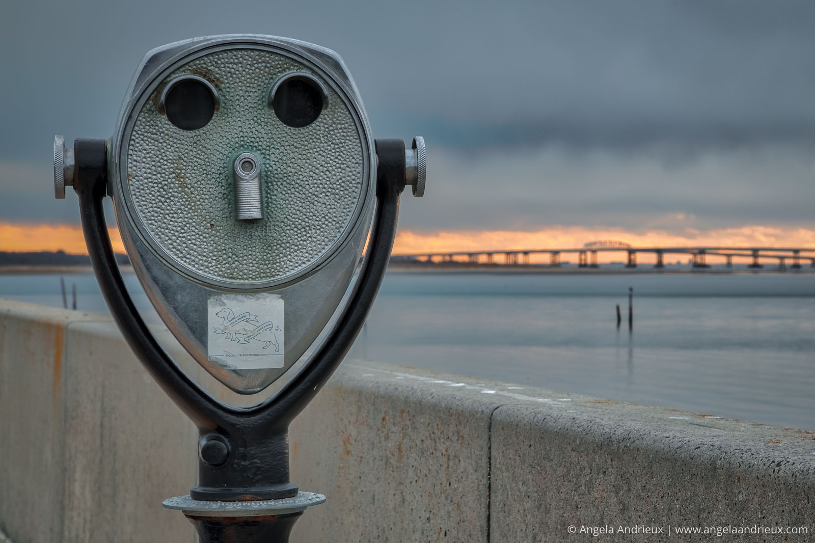 Telescope face with Chesapeake Bay Bridge Sunset in the Background