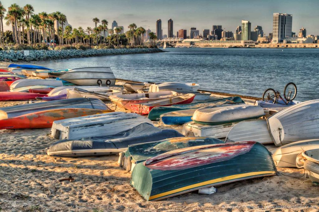 Colorful boats on the beach in Coronado with the San Diego Skyline in the background