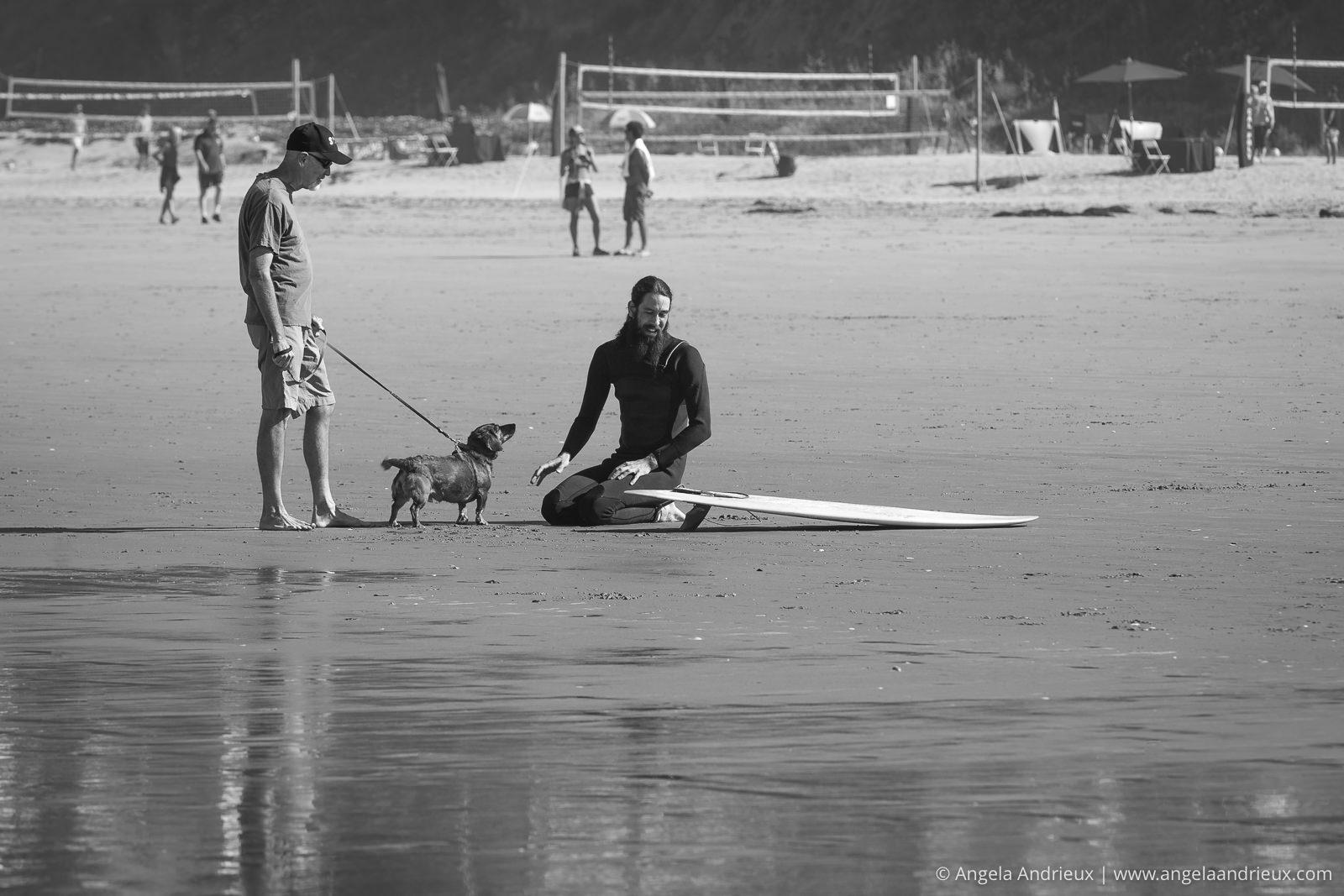 Conversation between a man, a dog, and an surfer | Pismo Beach Street Photography