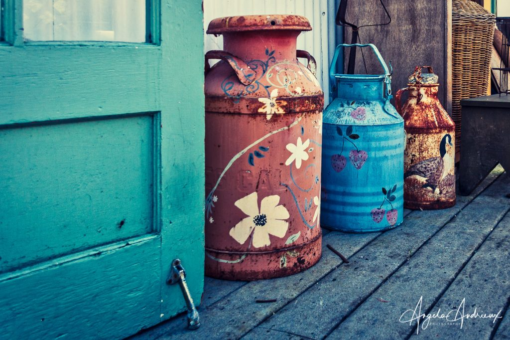Old milk cans at an antique store in Moss Landing, California