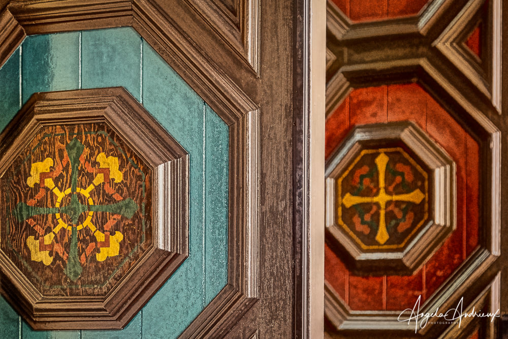 Red and turquoise painted details on doors in Balboa Park, San Diego