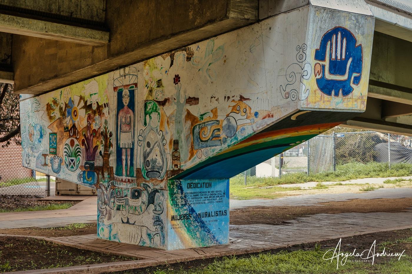 Freeway underpass painting mural in Barrio Logan, San Diego